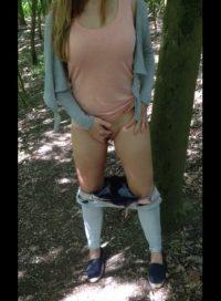 Blonde masturbating outdoors