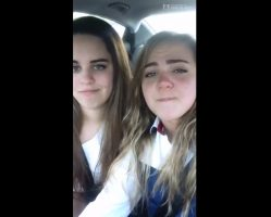 Beautiful girls kissing in the car