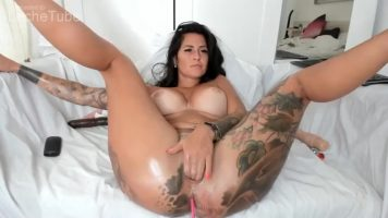 Tattooed milf caresses her creamy pussy and masturbates with live webcams